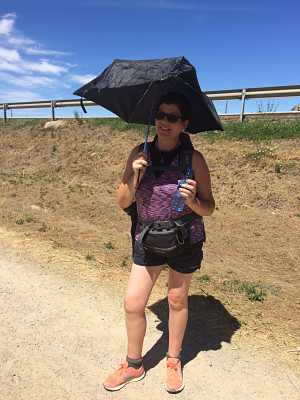 Standing on a hot sunny day with an umbrella