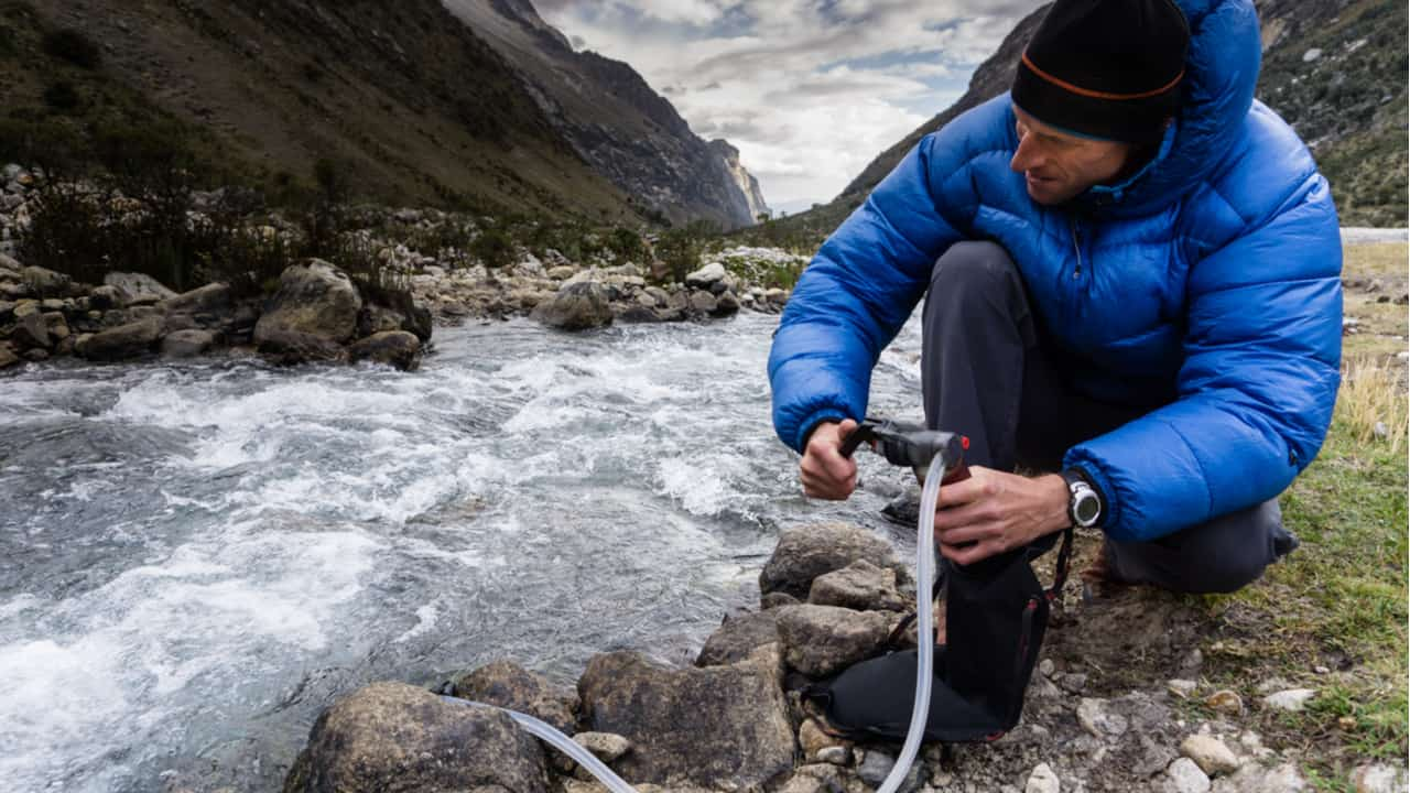 Hiker using a water filter