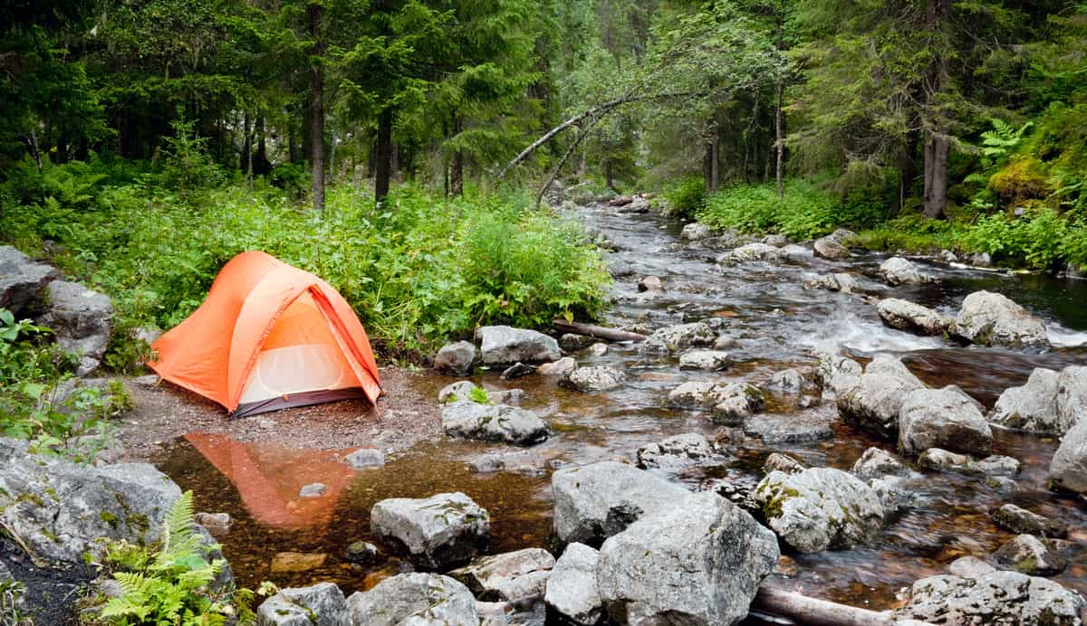 camping during the day by a river