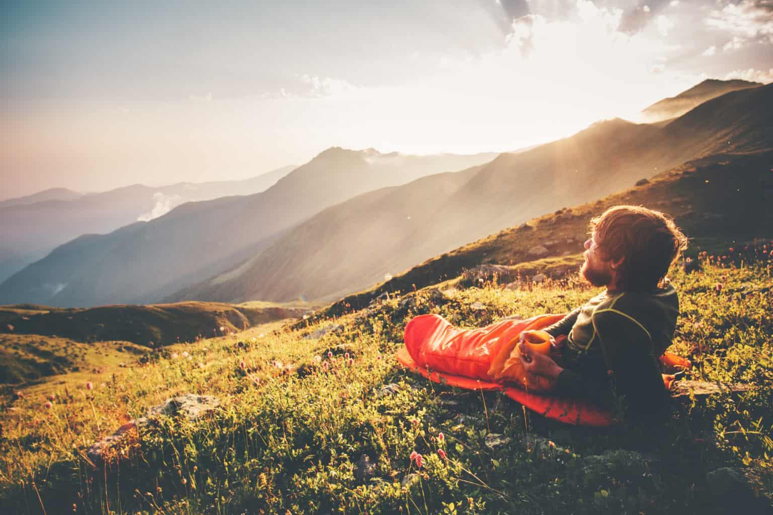 Man relaxing in sleeping bag