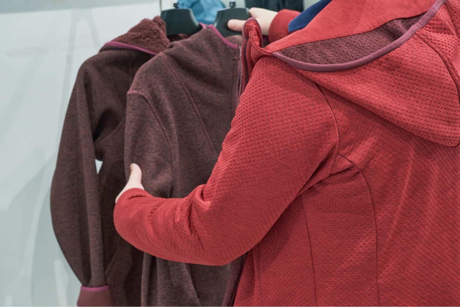 Woman shopping for a fleece jacket