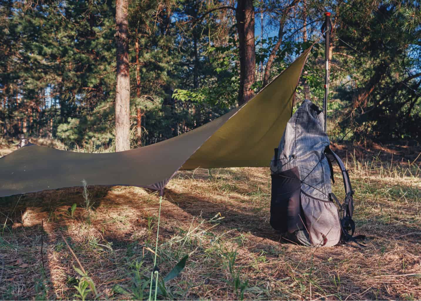 backpack next to tarp tent