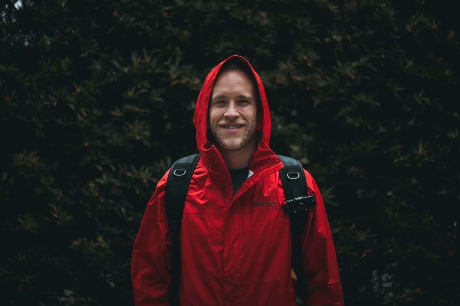 man wearing red jacket