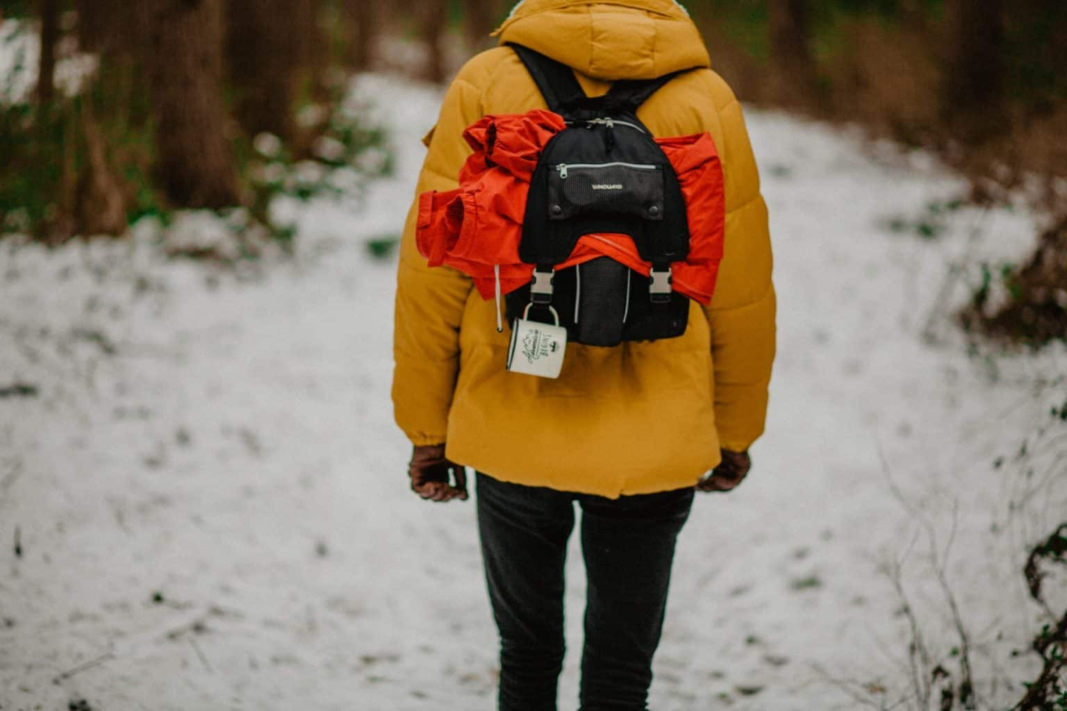 person wearing yellow down jacket