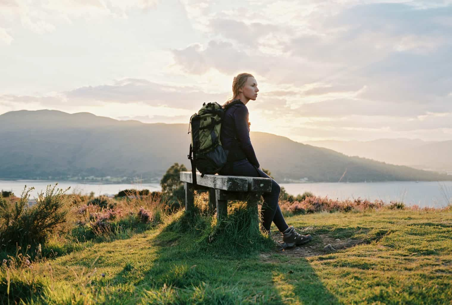 woman sitting on a bench in Fort William
