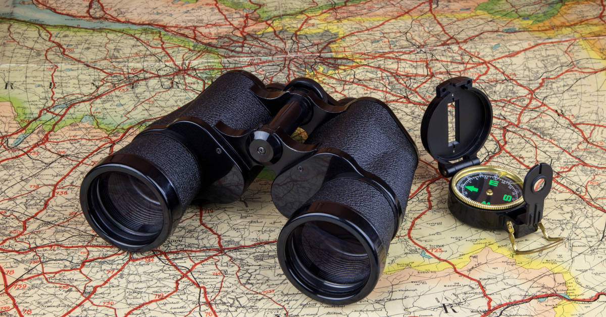 Binoculars and compass on a map of Scotland