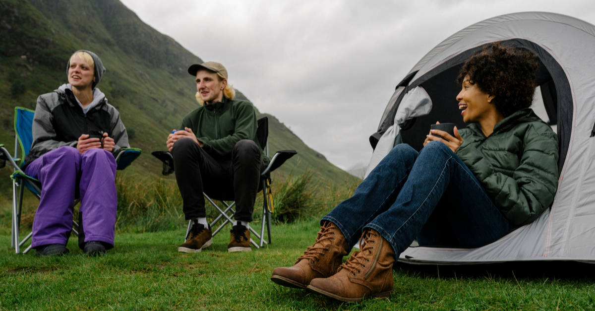Campers sitting in the Scottish Highlands
