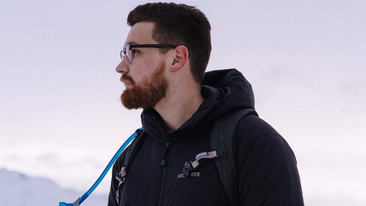 Hiker wearing an Arc'teryx jacket