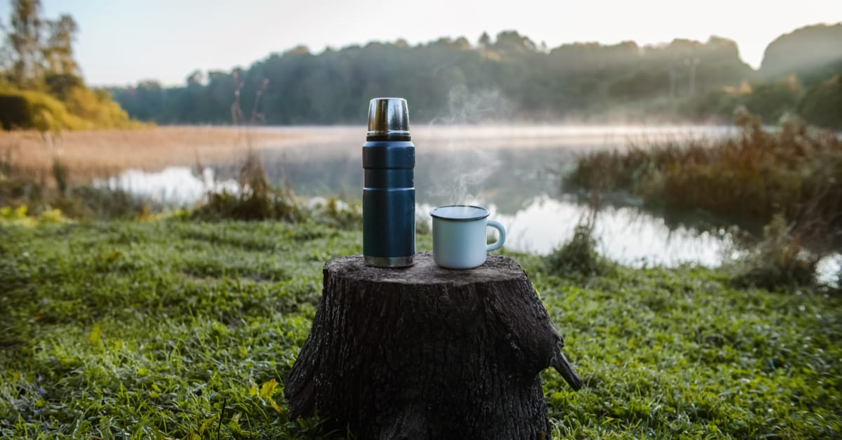 Thermos flask stands on a tree stump