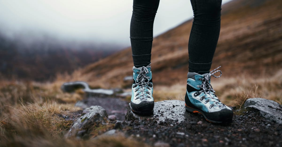 Woman wearing hiking shoes while hiking in Scotland