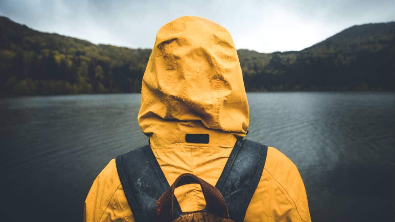 Hiker wearing a jacket in rain