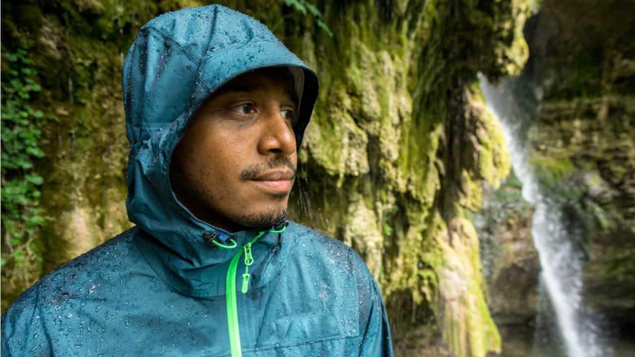 Hiker wears a waterproof jacket