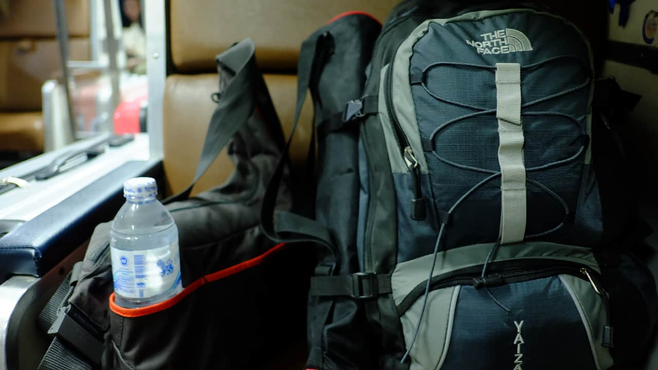 North Face Backpack on a train seat